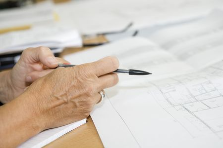 tabulation: Hand with a pencil and a plan