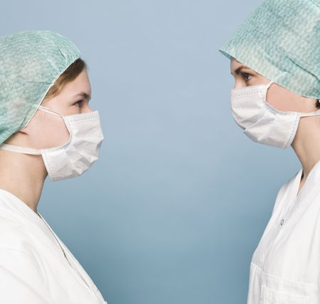 Two nurses with surgical masks photo