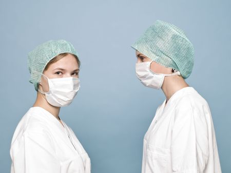 Two women with surgical masks photo
