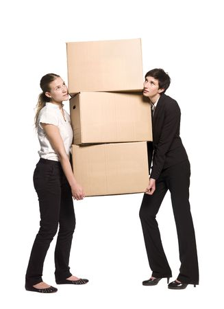 Two women carrying three boxes Stock Photo - 5011544