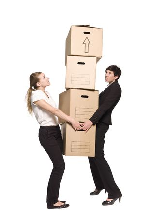 Two women carrying four boxes Stock Photo - 5011533