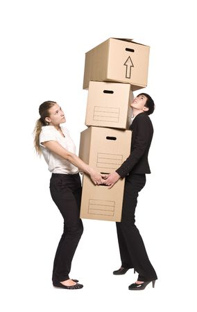 Two women carrying four boxes Stock Photo - 5011538