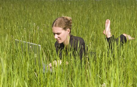 Woman with her computer in the grass Stock Photo - 5017137