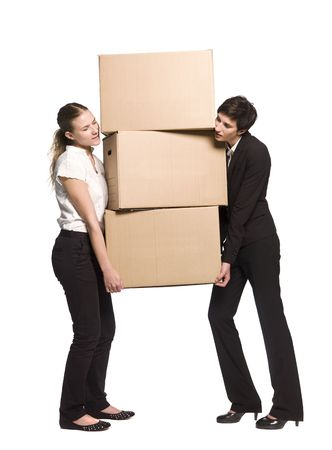 Two women carrying three boxes photo