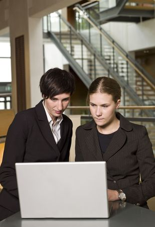 Two women in front of a laptop photo