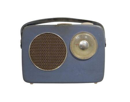 Worn vintage radio isolated towards white background photo