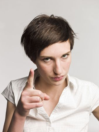 Portrait of a serious woman pointing with her finger photo