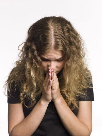 Portrait of a praying woman photo