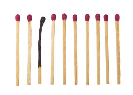 burnt wood: Matches on a row with one burned down. Stock Photo