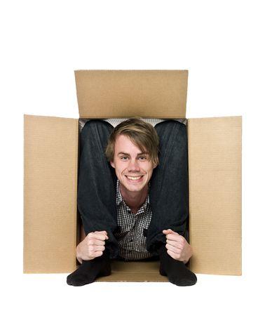confined: Acrobat inside of a cardboard box.