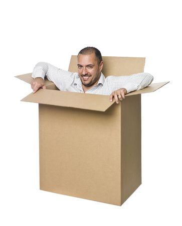 Man in a cardboard box. photo