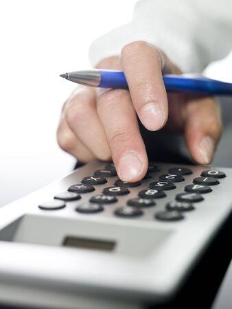 Man doing financial calculations. photo