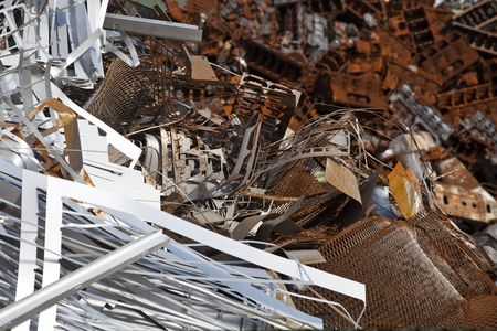 Rusty scrap metal in a junkyard photo