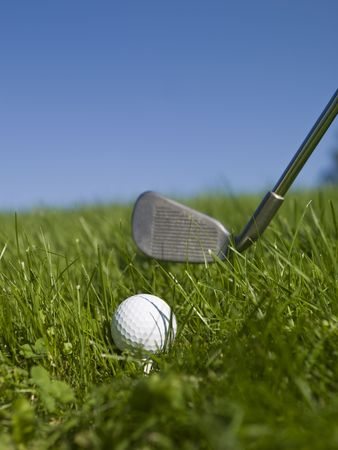 Golf ball and golf club in green gras  photo
