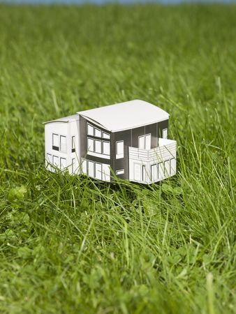 A miniature house outside in the sun. Stock Photo - 5531482