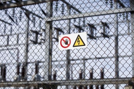 Warning signs on a fence with short focal depth. photo