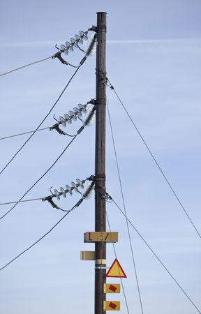 Warning signs on a electricity pylon with short focal depth