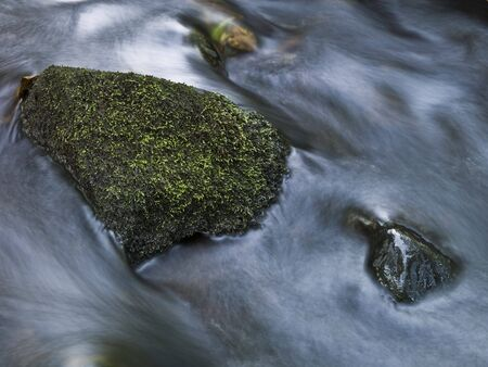 murky: Stone in a pitch shot with long exposure time. Stock Photo