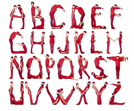 Group of red dressed people forming the alphabet. photo