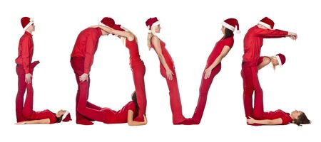 Group of red dressed people forming the word LOVE, isolated on white. photo