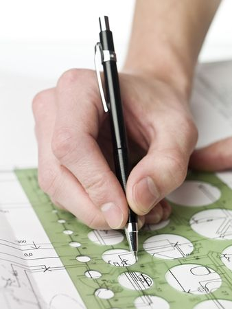 Male architect working on a bluprint, close up on hand and bluprint. Stock Photo - 5624506