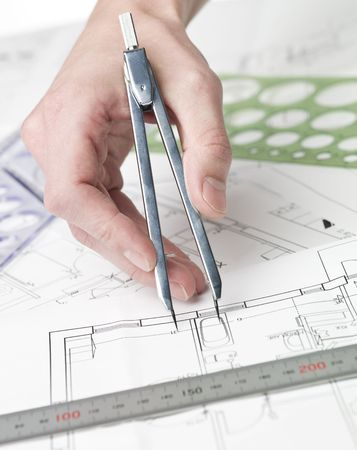 Male architect working on a bluprint, close up on hand and bluprint. Stock Photo - 5624501