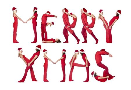 Group of red dressed people forming the phrase MERRY XMAS, isolated on white. photo