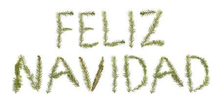 feliz: Spruce twigs forming the phrase Feliz Navidad isolated on white