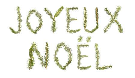joyeux: Spruce twigs forming the phrase Joyeux Noel isolated on white