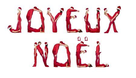 Elfs forming the phrase 'Joyeux Noel' isolated on white photo