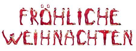 Elfs forming the phrase 'Fr�hliche Weihnachten' isolated on white photo
