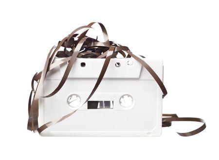 audio cassette: Broken audio cassette isolated on a white background Stock Photo