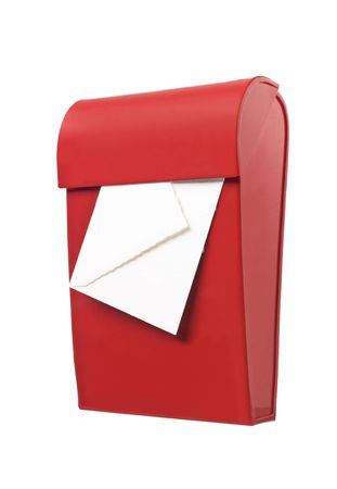 Red mailbox with mail in it isolated on a white background photo