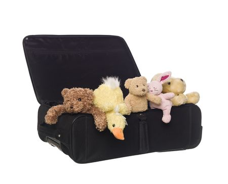 Suitcase with Toy Animals isolated on white background Stock Photo