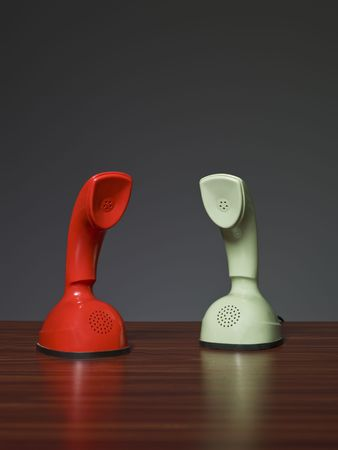 Two cobra phones on a desk with a grey background photo