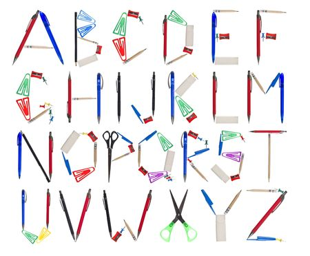 c r t: Office supplies forming the alphabet.