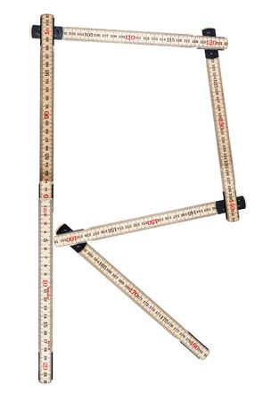 Letter R made of a folding ruler photo