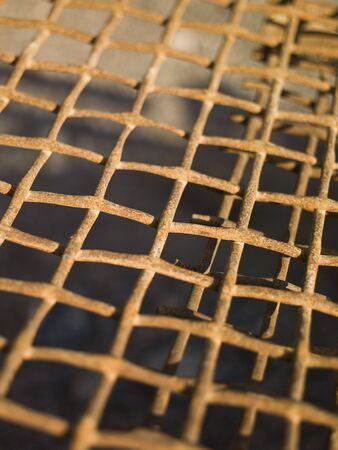 Close up on a rusty metal net
