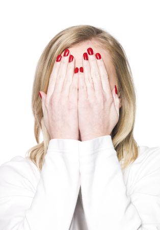 Young woman covering her face isolated a white background photo