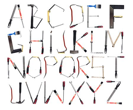 Tools forming the alphabet isolated against a white background photo