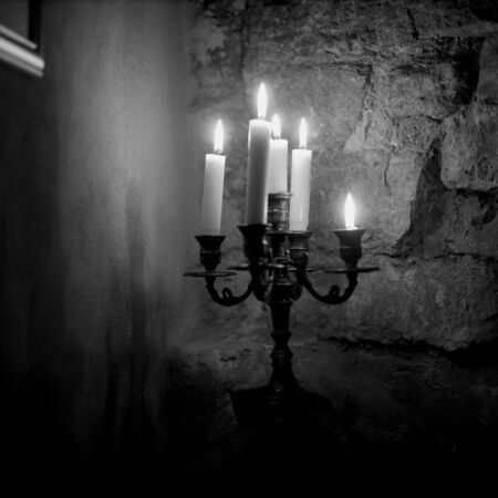 Candle lights in a dark basement  photo