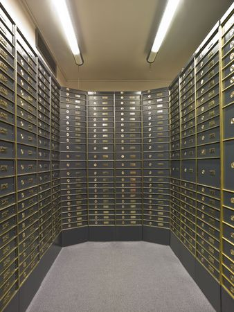 bank protection: Rows of luxurious safe deposit boxes in a bank vault