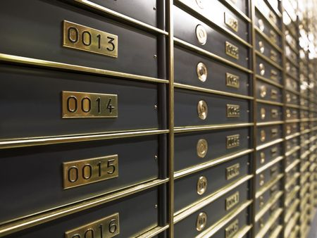bank safe: Rows of luxurious safe deposit boxes in a bank vault