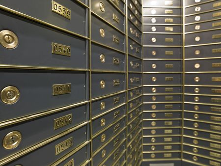 Rows of luxurious safe deposit boxes in a bank vault photo