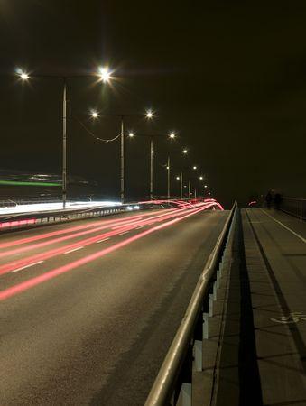 Traffic in movement on a bridge at night Stock Photo - 5981256