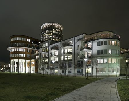 Recidential buildings at night with modern architecture photo