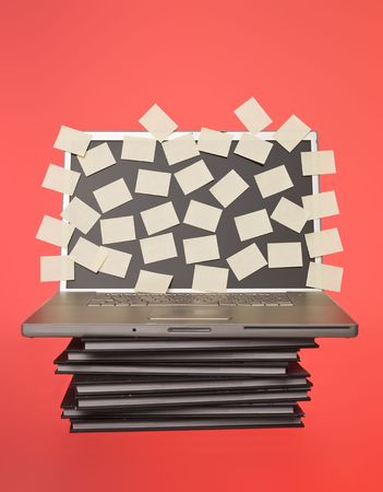 Grey laptop overflowed with empty post-its isolated  Stock Photo