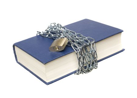 Book with a chain and lock wrapped around it photo