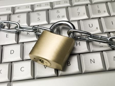 Chain and a lock on a keyboard photo
