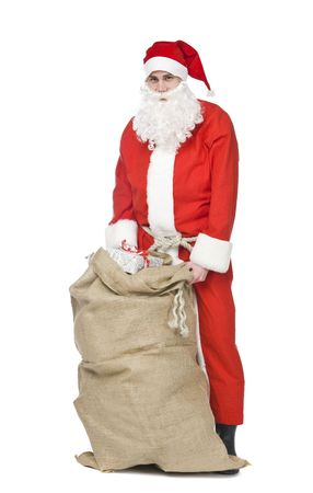 Santa claus with a sack og gifts isolated on a white background photo